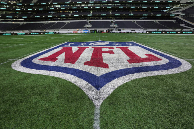 The NFL logo is seen on the pitch ahead of an NFL Academy training session at Tottenham Hotspur's White Hart Lane stadium in London, Wednesday, Oct. 13, 2021. The NFL is playing two regular season games in London during October, the Jets verses the Falcon's and the Dolphins against the Jaguars. The NFL Academy is aimed at pre college youngsters to give them a chance show off their talents in a days events. (AP Photo/Alastair Grant)