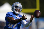 Detroit Lions receiver Quintez Cephus catches during a drill at the Lions NFL football camp practice, Wednesday, July 28, 2021, in Allen Park, Mich. (AP Photo/Carlos Osorio)