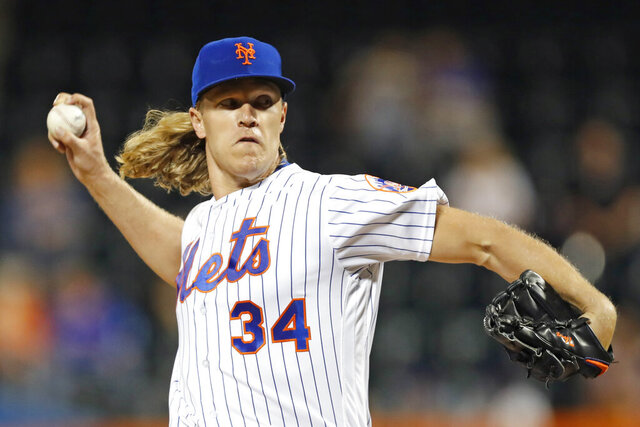 FILE - In this Sept. 24, 2019, file photo, New York Mets starting pitcher Noah Syndergaard winds up during the first inning of the team's baseball game against the Miami Marlins in New York. Right-hander Syndergaard has agreed to a $9.7 million, one-year deal with the Mets to avoid salary arbitration. (AP Photo/Kathy Willens, File)