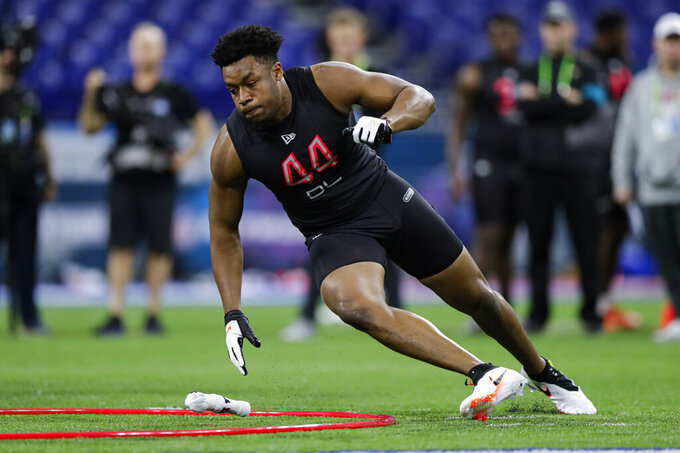 FILE - In this Feb. 29, 2020, file photo, South Carolina defensive lineman D J Wonnum runs a drill at the NFL football scouting combine in Indianapolis. The Minnesota Vikings selected Wonnum in the fourth round of the NFL football draft on Saturday, April 25, 2020. (AP Photo/Michael Conroy, File)