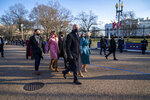President Joe Biden, First Lady Jill Biden and family, walk in front of the White House during a Presidential Escort to the White House, Wednesday, Jan. 20, 2021 in Washington.  (Doug Mills/The New York Times via AP, Pool)