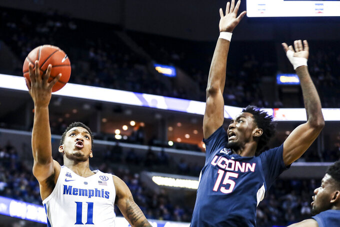 Memphis' Antwann Jones Jr., left, goes up for a shot against UConn's Sidney Wilson, right, during an NCAA college basketball game Sunday, Feb. 10, 2019, in Memphis, Tenn.  (Brad Vest/The Commercial Appeal via AP)
