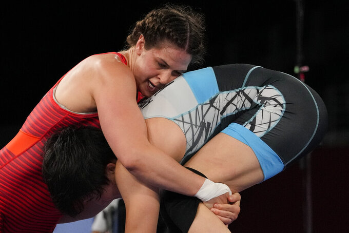 United States' Adeline Maria Gray, left, battles against Kyrgyzstan's Aiperi Medet Kyzy during the semi-final round of the women's 76kg freestyle wrestling match at the 2020 Summer Olympics, Sunday, Aug. 1, 2021 in Chiba, Japan. (AP Photo/Aaron Favila)