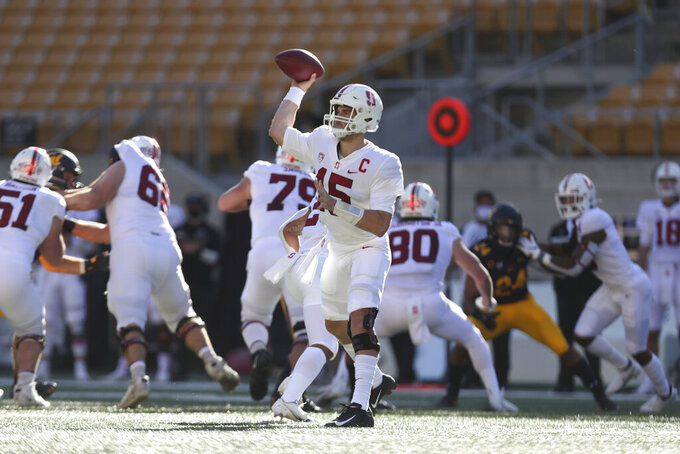Stanford quarterback Davis Mills (15) throws a pass against California during the first half of an NCAA college football game Friday, Nov. 27, 2020, in Berkeley, Calif. (AP Photo/Jed Jacobsohn)