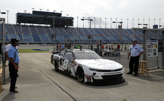 Zane Smith drives to his garage during a NASCAR Xfinity Series auto race practice at Chicagoland Speedway in Joliet, Ill., Friday, June 28, 2019. (AP Photo/Nam Y. Huh)