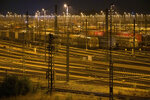 Freight wagons stand at the freight station during a strike in Maschen, Germany, late Tuesday, Aug. 10, 2021. The head of the GDL union, Claus Weselsky, told reporters the strike would start with all cargo trains at 7 p.m. (1700 GMT) Tuesday and expand to include passengers trains from 2 a.m. (0000 GMT) Wednesday until 2 a.m. Friday. German train operator Deutsche Bahn has rejected the demands. (Jonas Walzberg/dpa via AP)