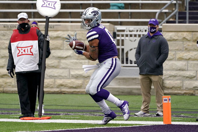 Kansas State tight end Briley Moore catches a pass before stepping into the end zone to score a touchdown during the first half of an NCAA college football game against Kansas Saturday, Oct. 24, 2020, in Manhattan, Kan. (AP Photo/Charlie Riedel)