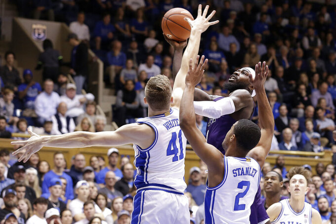 Stephen F. Austin guard Kevon Harris drives to the basket against Duke forward Jack White (41) and guard Cassius Stanley (2) during the first half of an NCAA college basketball game in Durham, N.C., Tuesday, Nov. 26, 2019. (AP Photo/Gerry Broome)