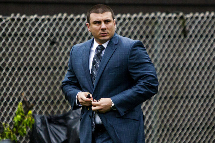 FILE - In this May 13, 2019, file photo, New York City police officer Daniel Pantaleo leaves his house in Staten Island, N.Y. Time is running out for federal prosecutors to take action in the 2014 death of Eric Garner, the unarmed black man heard on video crying