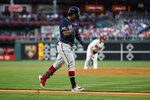 Atlanta Braves' Ronald Acuna Jr., left, rounds the bases after hitting a home run off Philadelphia Phillies starting pitcher Aaron Nola during the first inning of a baseball game, Monday, Sept. 9, 2019, in Philadelphia. (AP Photo/Matt Slocum)