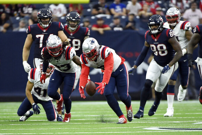New England Patriots linebacker Matt Judon (9) recovers a fumble against the Houston Texans during the second half of an NFL football game Sunday, Oct. 10, 2021, in Houston. The Patriots won 25-22. (AP Photo/Justin Rex)