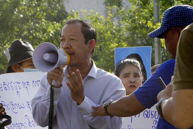FILE - In this July 29, 2020, file photo, Rong Chhun, president of the Cambodian Confederation of Unions, uses a megaphone during a protest near the prime minister's residence in Phnom Penh, The United Nations human rights office called Friday for Cambodia to release Rong Chhun and other detained human rights and environmental activists, saying at least two dozen have been arrested because of their work in recent weeks. (AP Photo/Heng Sinith, File)