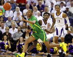 Oregon forward Louis King, left, passes around Washington forward Nahziah Carter, center, during the first half of an NCAA college basketball game, Saturday, March 9, 2019, in Seattle. (AP Photo/Ted S. Warren)