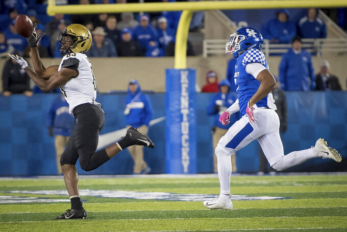 Vanderbilt wide receiver C.J. Bolar (83) catches a pass during the second half of an NCAA college football game against Kentucky in Lexington, Ky., Saturday, Oct. 20, 2018. Kentucky won, 14-7. (AP Photo/Bryan Woolston)