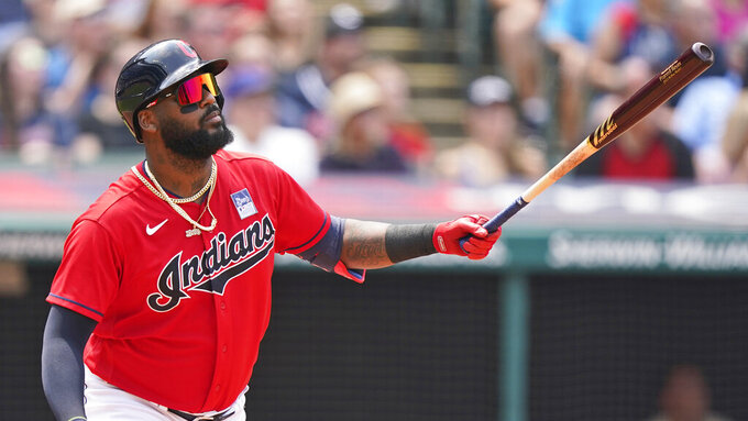 Cleveland Indians' Franmil Reyes watches his solo home run in the third inning of a baseball game against the St. Louis Cardinals, Wednesday, July 28, 2021, in Cleveland. (AP Photo/Tony Dejak)
