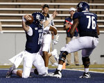 Rice quarterback Tom Stewart (14) celebrates with offensive lineman Justin Gooseberry (76) as he comes off the end after scoring against Wake Forest during the first half of an NCAA college football game Friday, Sept. 6, 2019, in Houston. (AP Photo/Michael Wyke)