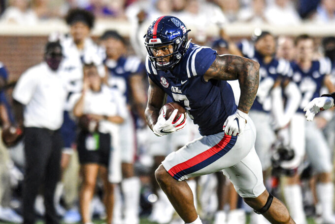 Mississippi defensive lineman Sam Williams (7) runs to score after recovering a fumble during an NCAA college football game against Austin Peay in Oxford, Miss., Saturday, Sept. 11, 2021. (AP Photo/Bruce Newman)