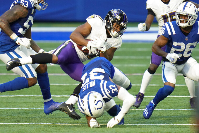 Baltimore Ravens running back J.K. Dobbins (27) is tackled by Indianapolis Colts strong safety Khari Willis (37) in the second half of an NFL football game in Indianapolis, Sunday, Nov. 8, 2020. (AP Photo/AJ Mast)