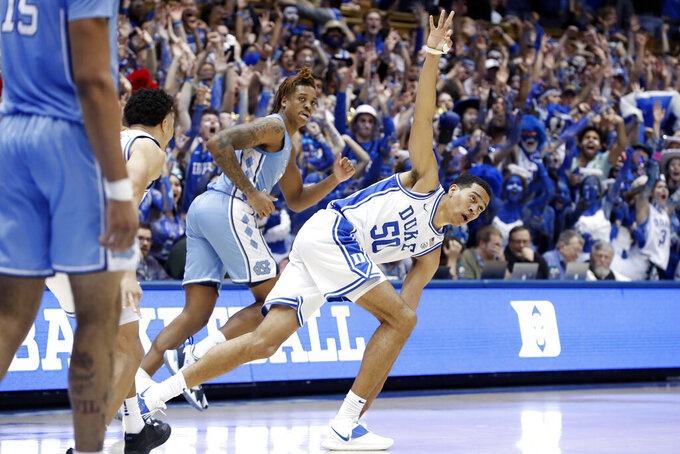 Duke forward Justin Robinson (50) reacts following a three-point basket against North Carolina during the second half of an NCAA college basketball game in Durham, N.C., Saturday, March 7, 2020. (AP Photo/Gerry Broome)