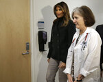First lady Melania Trump, left, walks with pediatrician Eileen Costello, right, during a visit to Boston Medical Center, in Boston, Wednesday, Nov. 6, 2019. The visit, part of the first lady's