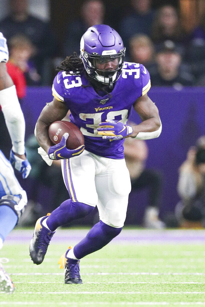 Minnesota Vikings running back Dalvin Cook (33) carries the ball in an NFL game against the Detroit Lions, Sunday, Dec. 8, 2019 in Minneapolis. The Vikings defeated the Lions 20-7. (Margaret Bowles via AP)