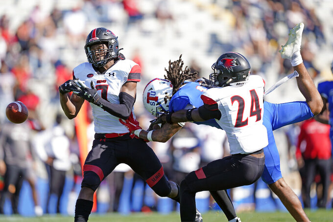 Southeast Missouri State defenders Lawrence Johnson (7) and Shabari Davis (24) break up a pass intended for Tennessee State wide receiver Zaire Thornton during an NCAA college football game Sunday, April 11, 2021, in Nashville, Tenn. Because of COVID-19, the OVC postponed the 2020 season to the spring, and the decision was made to play games on Sunday because member schools needed flexibility to staff all the spring sports. (AP Photo/Mark Humphrey)