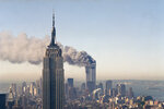 FILE - The twin towers of the World Trade Center burn behind the Empire State Building, Tuesday Sept. 11, 2001. in New York. (AP Photo/Marty Lederhandler, File)