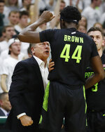 Michigan State head coach Tom Izzo, left, yells at forward Gabe Brown after a dunk during the second half of an NCAA college basketball game against Wisconsin, Friday, Jan. 17, 2020, in East Lansing, Mich. (AP Photo/Carlos Osorio)