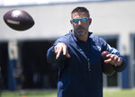 Tennessee Titans coach Mike Vrabel tosses a football during NFL football minicamp Tuesday, June 15, 2021, in Nashville, Tenn. (George Walker IV/The Tennessean via AP, Pool)