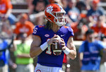 FILE - In this April 6, 2019, file photo, Clemson's Trevor Lawrence drops back to pass during Clemson's annual Orange and White NCAA college football spring scrimmage in Clemson, S.C. After leading Clemson to a national championship as a freshman, Lawrence was selected an AP preseason All-American by poll voters. (AP Photo/Richard Shiro, File)