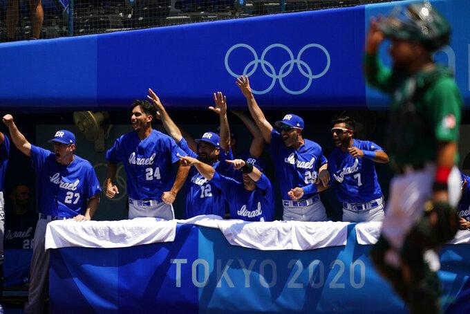 Israel players react after Danny Valencia hit a three-run home run by during a baseball game against Mexico at Yokohama Baseball Stadium during the 2020 Summer Olympics, Sunday, Aug. 1, 2021, in Yokohama, Japan. (AP Photo/Matt Slocum)