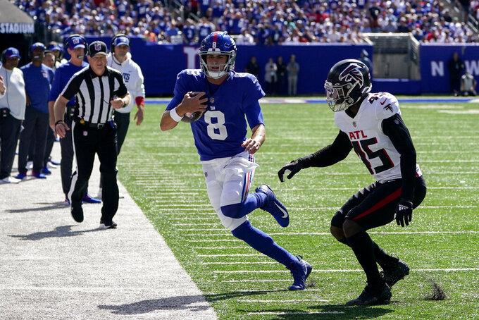 New York Giants quarterback Daniel Jones (8) runs the ball against Atlanta Falcons linebacker Deion Jones (45) during the first half of an NFL football game, Sunday, Sept. 26, 2021, in East Rutherford, N.J. (AP Photo/Seth Wenig)