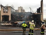 Firefighters in Duluth, Minn., battle a blaze at the Adas Israel Congregation on Monday, Sept. 9, 2019. A preliminary investigation has found no signs of accelerants at the fire that destroyed the historic synagogue in northern Minnesota, authorities said Monday. (Dan Kraker/Minnesota Public Radio via AP)