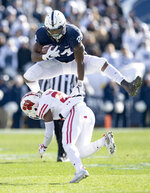 Penn State running back Miles Sanders hurdles Wisconsin's Faion Hicks during an NCAA college football game Saturday, Nov. 10, 2018, in State College, Pa. (Abby Drey/Centre Daily Times via AP)