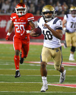 Navy quarterback Malcolm Perry (10) runs the ball during the first half of an NCAA college football game against Houston, Saturday, Nov. 30, 2019, in Houston. (AP Photo/Eric Christian Smith)