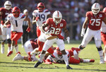 Stanford's Nathaniel Peat, center, rushes against Arizona in the second half of an NCAA college football game Saturday, Oct. 26, 2019, in Stanford, Calif. (AP Photo/Ben Margot)