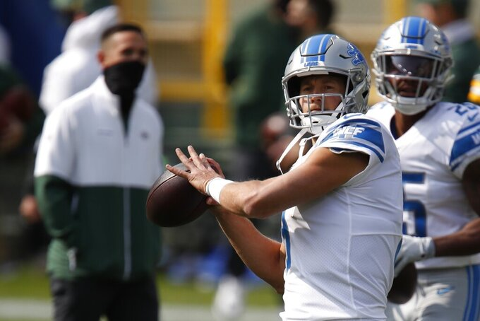 Detroit Lions' Matthew Stafford warms up before an NFL football game against the Green Bay Packers Sunday, Sept. 20, 2020, in Green Bay, Wis. (AP Photo/Matt Ludtke)