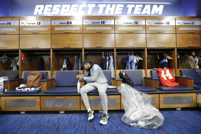 Tennessee Titans wide receiver Tajae Sharpe gathers items as players clean out their lockers Monday, Jan. 20, 2020, in Nashville, Tenn. The Titans lost the AFC Championship NFL football game Sunday to the Kansas City Chiefs. (AP Photo/Mark Humphrey)
