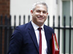 FILE - In this Monday, Jan. 21, 2019 file photo, Britain's Brexit Secretary Stephen Barclay smiles to the media as he walks along Downing Street in London. EU chief negotiator Michel Barnier is meeting U.K. Brexit Secretary Stephen Barclay and Attorney General Geoffrey Cox Tuesday March 5, 2019, as Britain seeks changes to a Brexit divorce deal that has been rejected by U.K. lawmakers. (AP Photo/Kirsty Wigglesworth, File)