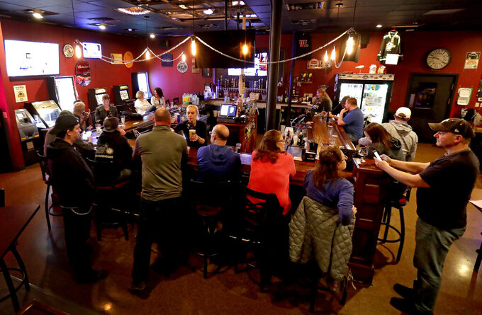 FILE - In this May 13, 2020 file photo, the Dairyland Brew Pub opens to patrons in Appleton, Wis. The Wisconsin Supreme Court on Wednesday, April 14, 2021, ruled that Gov. Tony Evers' administration does not have the authority to issue capacity limits on bars, restaurants and other businesses without approval of the Legislature, a ruling that comes two weeks after the conservative-controlled court struck down the state's mask mandate.  (William Glasheen/The Post-Crescent via AP, File)