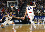 Gonzaga's Josh Perkins (13) reaches for Corey Kispert (24) after Kispert's 3-pointer against Baylor during the second half of a second-round game in the NCAA men's college basketball tournament Saturday, March 23, 2019, in Salt Lake City. (AP Photo/Rick Bowmer)