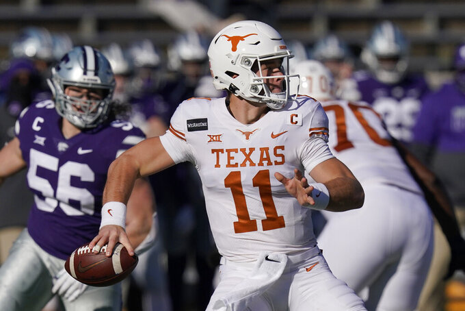 Texas quarterback Sam Ehlinger (11) passes to a teammate during the first half of an NCAA college football game against Kansas State in Manhattan, Kan., Saturday, Dec. 5, 2020. (AP Photo/Orlin Wagner)