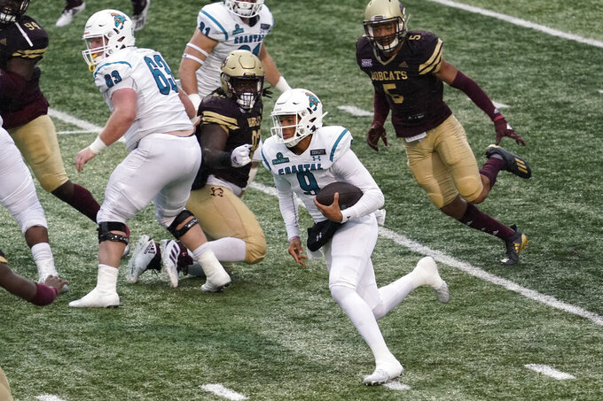 Coastal Carolina's Fred Payton (9) runs against Texas State during the second half of an NCAA college football game in San Marcos, Texas, Saturday, Nov. 28, 2020. (AP Photo/Chuck Burton)