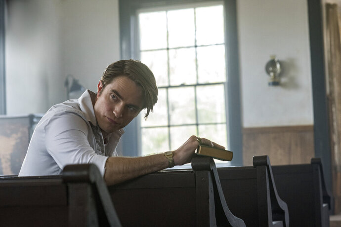This image released by Netflix shows Robert Pattinson in a scene from