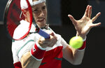 John Isner of the U.S. makes a forehand return to Brazil's Thiago Monteiro during their first round singles match at the Australian Open tennis championship in Melbourne, Australia, Tuesday, Jan. 21, 2020. (AP Photo/Dita Alangkara)