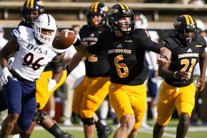 Southern Mississippi quarterback Tate Whatley (6) passes while pursued by UTSA linebacker Charles Wiley (96) during the first half of an NCAA college football game, Saturday, Nov. 21, 2020, in Hattiesburg, Miss. (AP Photo/Rogelio V. Solis)