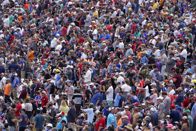 Fans watch the start of the IndyCar auto race at Indianapolis Motor Speedway, Saturday, May 15, 2021, in Indianapolis. (AP Photo/Darron Cummings)