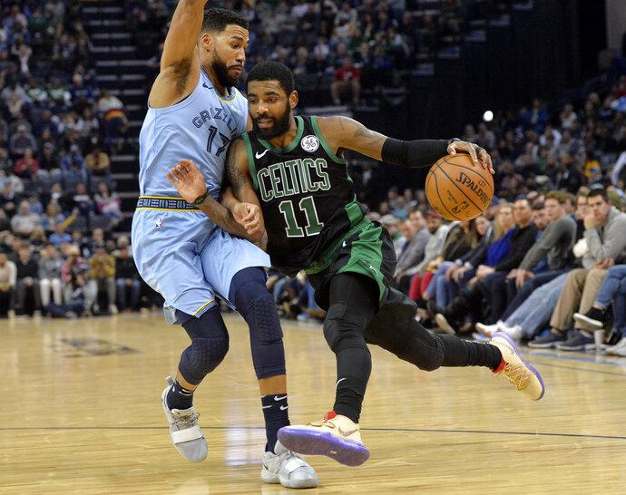 Boston Celtics guard Kyrie Irving (11) drives against Memphis Grizzlies guard Garrett Temple (17) during the second half of an NBA basketball game Saturday, Dec. 29, 2018, in Memphis, Tenn. (AP Photo/Brandon Dill)