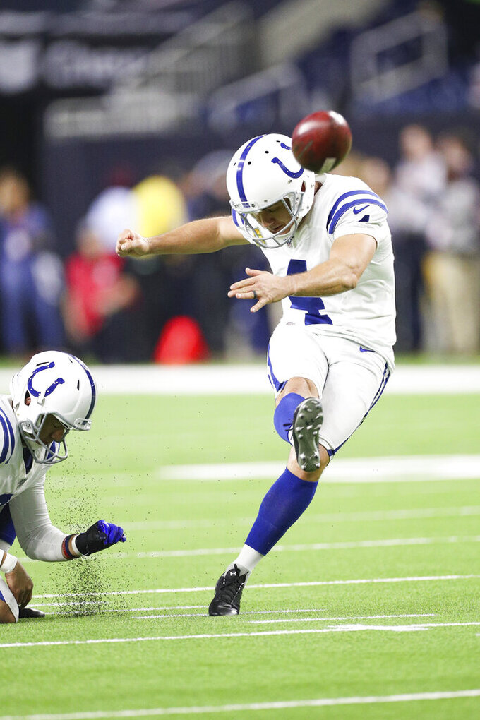 Indianapolis Colts kicker Adam Vinatieri (4) kicks a field goal during warm-ups in an NFL game against the Houston Texans, Thursday, Nov. 21, 2019 in Houston. The Texans defeated the Colts 20-17. (Margaret Bowles via AP)