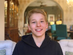 This Monday, May 4, 2020 photo provided by his family shows Hudson Drutchas, 12, in his Chicago home. Drutchas is a sixth-grader and is, because he lives in a state that still has a stay-at-home order, is doing his schoolwork online. He says he feels like he's missing part of his childhood because of the global pandemic. (Kristin Drutchas via AP)
